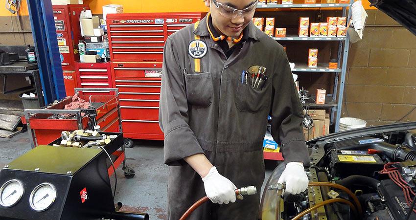 Minit-Tune & Brake mechanic checking car transmission