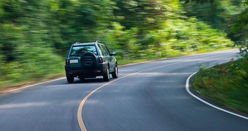 Car cornering on highway
